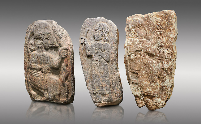Hittite monumental relief sculptures, 900 - 700 BC, from Adana Archaeology Museum, Turkey. Against a grey background