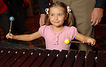 Grace Suerth,4, plays the xylophone at the Houston Symphony League's annual Magical Musical Morning event at the Houstonian Saturday Dec. 12,2009.(Dave Rossman/For the Chronicle)
