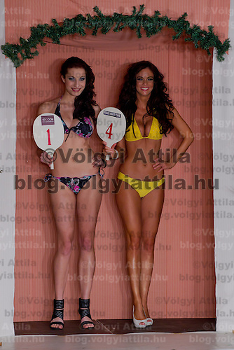 Contest director Lajos Repas (C) poses with Edina Szommer (L) winner of the Teen Miss Hungary contest and Marianna Bertok (R) winner of the Miss Hungary beauty contest held in Budapest, Hungary on December 29, 2011. ATTILA VOLGYI
