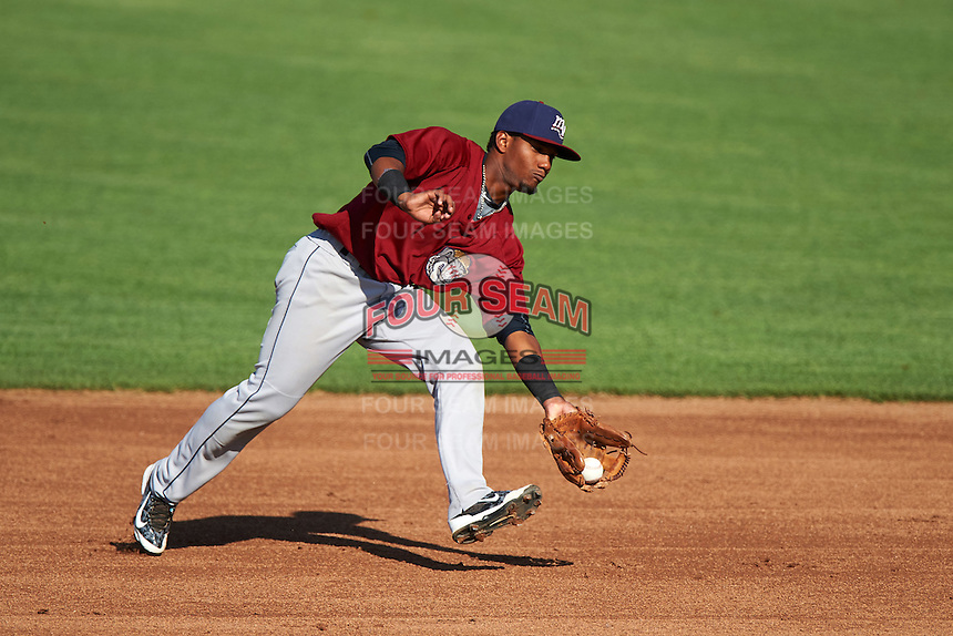 Mahoning Valley Scrappers second baseman Erlin Cerda (4) fields a ground ball during a game against the Auburn Doubledays on July 17, 2016 at Falcon Park in Auburn, New York.  Mahoning Valley defeated Auburn 3-2.  (Mike Janes/Four Seam Images)