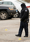 WATERBURY, CT-011518JS09--A Waterbury police walks past tagged shell casings as they investigate a shooting that occurred Tuesday at  the Mallview Condominium on Mark Lane in Waterbury. <br />   Jim Shannon Republican-American
