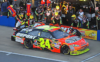 Nov. 1, 2009; Talladega, AL, USA; NASCAR Sprint Cup Series driver Jeff Gordon pits during the Amp Energy 500 at the Talladega Superspeedway. Mandatory Credit: Mark J. Rebilas-