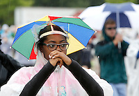 NWA Democrat-Gazette/DAVID GOTTSCHALK   Sharida Holloway, a piccolo player, practices marching Wednesday, August 19, 2015 in the rain with the Razorback Marching Band on the campus of the University of Arkansas in Fayetteville. The 350 member band is now under the direction Ben Lorenzo.