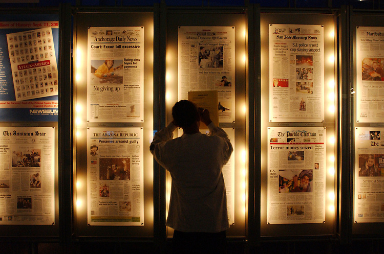 1newseum110801 -- Avery Biles, a D.C. fifth grader, takes notes from the daily front pages from newspapers from around the world at the Newseum in Rosslyn, Va.