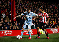 11th February 2020; Griffin Park, London, England; English Championship Football, Brentford FC versus Leeds United; Bryan Mbeumo of Brentford challenges Mateusz Klich of Leeds United