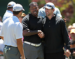 From left, Tony Romo, Joey Porter and Aaron Rodgers talk on the putting green before their practice round at the American Century Championship golf tournament at Edgewood Tahoe at Stateline, Nev., on Wednesday, July 18, 2012..Photo by Cathleen Allison