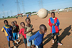 SOWETO, SOUTH AFRICA - OCTOBER 23: Unidentified boys warm up before a soccer a practice on October 23, 2007 in the Diepkloof section Soweto, South Africa. Soccer is the most popular sport in South Africa, and a because of the upcoming World Cup 2010 in South Africa the interest is increasing. For the first time the World Cup will be held on the African continent. South Africa doesn't have an organized youth soccer program and many teams and players struggle with lack of funds, to buy equipment and money for transport to games. .(Photo by Per-Anders Pettersson)...