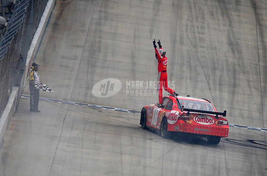 Jun 1, 2008; Dover, DE, USA; NASCAR Sprint Cup Series driver Kyle Busch celebrates after winning the Best Buy 400 at the Dover International Speedway. Mandatory Credit: Mark J. Rebilas-US PRESSWIRE