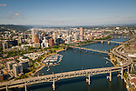 Aerial view looking northwest at downtown Portland, Oregon with the marina and Willamette River in the foreground.