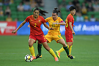 22 November 2017, Melbourne - LIU SHANSHAN (2) of China PR and LISA DE VANNA (11) of Australia fight for the ball during an international friendly match between the Australian Matildas and China PR at AAMI Stadium in Melbourne, Australia.. Australia won 5-1. Photo Sydney Low