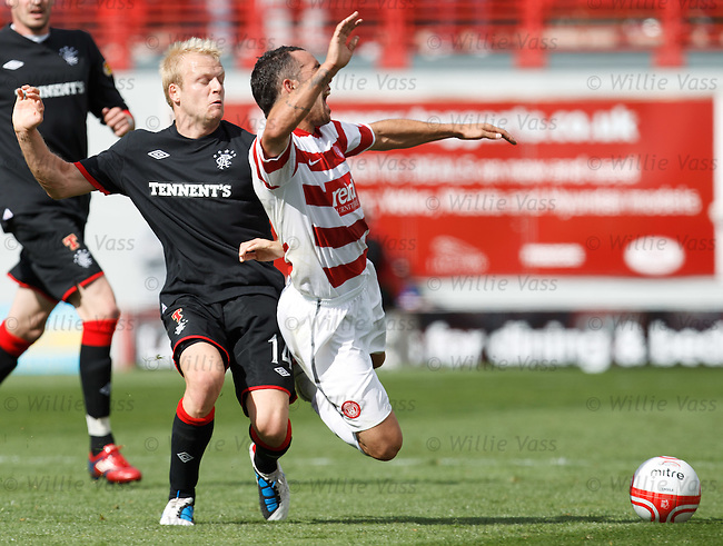 Steven Naismith booked for getting a revenge challenge in on Dougie Imrie after the Rangers man was flattened by Imrie