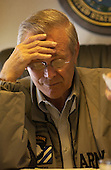United States Secretary of Defense Donald Rumsfeld concentrates on paperwork en route to Andrews Air Force Base,  Maryland, on September 8, 2003.  Rumsfeld is heading home after a six-day trip to Iraq and Afghanistan.  <br /> Mandatory Credit: Andy Dunaway / DoD via CNP