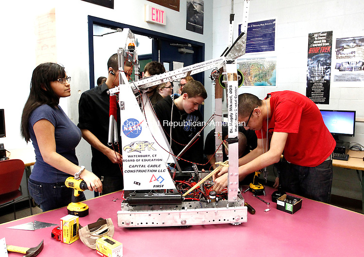 Waterbury, CT- 02 April 2014-040214CM10-  The Kennedy High School robotics team makes last minute preparations on their robot at the high school on Wednesday.  The team will travel to Maine this weekend for their last competition of the season.    Christopher Massa Republican-American