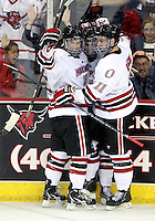 Nebraska Omaha's Ryan Walters (19) and Jayson Megna (11) celebrate Josh Archibald's (15) first collegiate goal during the second period of UNO's game against Mercyhurst. (Photo by Michelle Bishop).