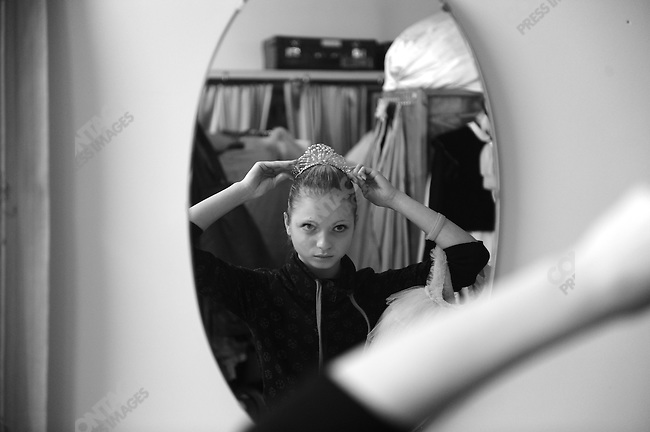 Students from the fourth and fifth years at the Vaganova Ballet Academy in St. Petersburg, looked for their costumes for a dress reheasal of a stage performance at the school, part of the preparation the academy makes, even of young students, for performance on the real stage.  Here a girl tried on her tiara. March 19, 2009