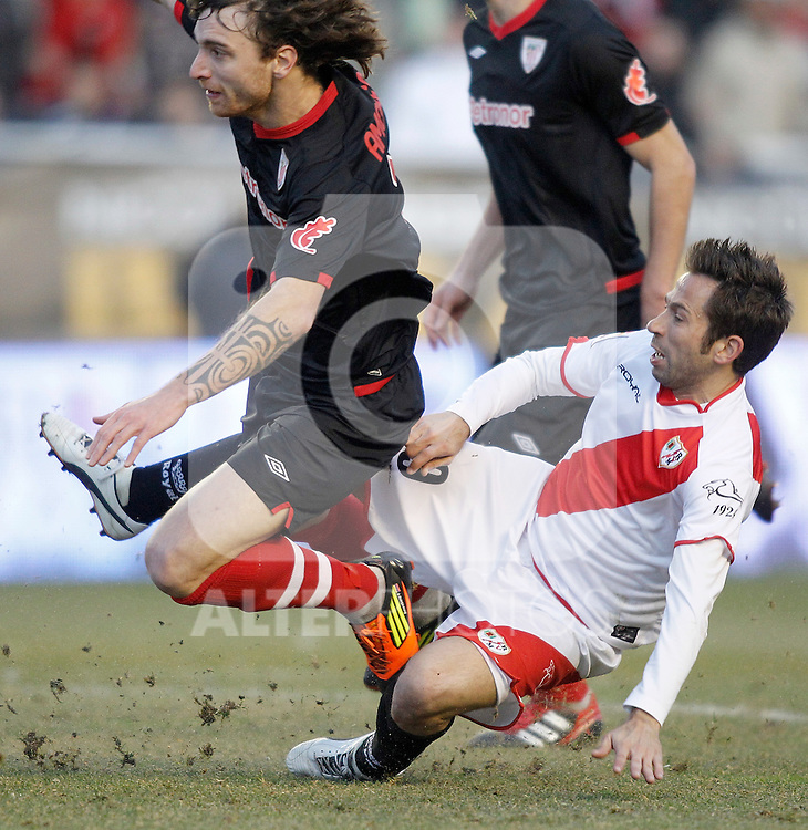 Rayo Vallecano's Raul Tamudo against Athletic de Bilbao's Fernando Amorebieta during La Liga match. January 28, 2012. (ALTERPHOTOS/Alvaro Hernandez)