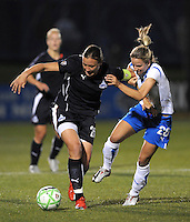 Washington Freedom forward Abby Wambach (20) pushes away Boston Breaker defender Sue Weber (20).Boston Breakers defeated Washington Freedom 3-1   at The Maryland SoccerPlex, Saturday April 18, 2009.