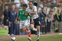Fernando Arce fights off Ramiro Corrales for the ball. USA and Mexico tied, 2-2, in an international friendly at Reliant Stadium, Houston, Texas on February 6, 2008.