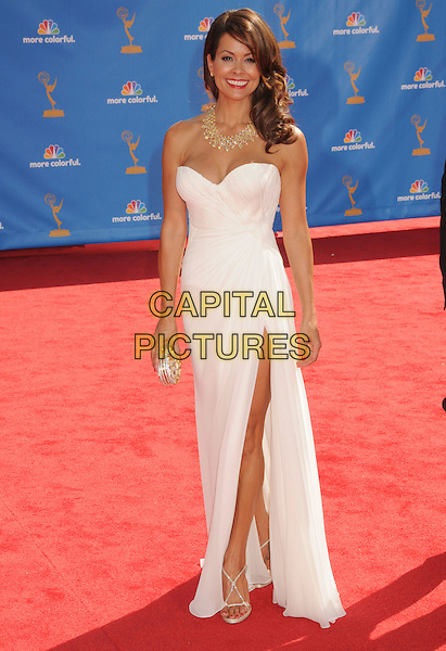 BROOKE BURKE .62nd Annual Primetime Emmy Awards held at NOKIA Theatre L.A. LIVE, Los Angeles, California, USA..August 29th, 2010.full length dress slit split clutch bag  strapless side gold necklace white .CAP/ADM/BP.©Byron Purvis/AdMedia/Capital Pictures.