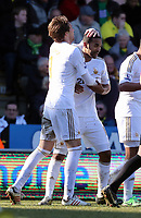 Pictured: Luke Moore (R) of Swansea celebrating his equaliser with co-scorer Michu (L). Saturday 06 April 2013<br />