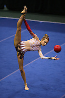 Brenann Stacker of USA (shot from balcony above), moment of recatch with ball at San Francisco Invitational on February 11, 2006. Stacker placed 3rd in All-Around competition.  (Photo by Tom Theobald)