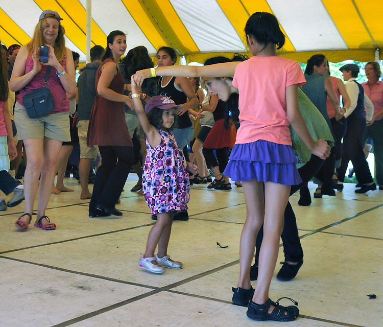 Members of the Vanaver Caravan Dance Troupe dancing with members of the audience at the Dance Stage, on the first day of the Clearwater's Great Hudson River Revival Festival 2013, held at Croton Point Park, in Croton-on-Hudson, NY, June 15, 2013. Photo by Jim Peppler. Copyright Jim Peppler 2013 all rights reserved.