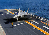 An F-35B Lightning II  makes the first vertical landing on a flight deck at sea aboard the amphibious assault ship USS Wasp (LHD 1) in the Atlantic Ocean on October 3, 2011. The F-35B is the Marine Corps Joint Strike Force variant of the Joint Strike Fighter and is designed for short takeoff and vertical landing on Navy amphibious ships..Mandatory Credit: Natasha R. Chalk - USN via CNP