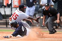 GCL Braves pitcher Felix Falcon (45) attempts to catch a throw from the catcher as Angel Aguilar (2) slides in safely with umpire J.C. Velez looking on during a game against the GCL Yankees 2 on June 23, 2014 at the Yankees Minor League Complex in Tampa, Florida.  GCL Yankees 2 defeated the GCL Braves 12-4.  (Mike Janes/Four Seam Images)