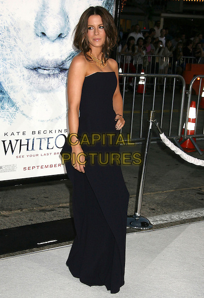 """KATE BECKINSALE .""""Whiteout"""" Los Angeles Premiere held at Mann's Village Theatre, Westwood, California, USA. .September 9th, 2009 .full length strapless black dress hand on hip long maxi.CAP/ADM/MJ.©Michael Jade/AdMedia/Capital Pictures."""