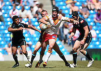 PICTURE BY VAUGHN RIDLEY/SWPIX.COM - Rugby League - Super League Magic Weekend - Catalans Dragons v London Broncos - Eithad Stadium, Manchester, England - 27/05/12 - Catalans Steve Menzies is pulled back by Londons Jamie O'Callaghan.