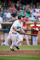 Dayton Dragons designated hitter James Vasquez (25) follows through on a swing during a game against the Cedar Rapids Kernels on May 10, 2017 at Fifth Third Field in Dayton, Ohio.  Cedar Rapids defeated Dayton 6-5 in ten innings.  (Mike Janes/Four Seam Images)