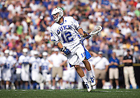 Justin Turri (12) of duke looks for a teammate to pass to during the NCAA Men's Lacrosse Championship held at M&T Stadium in Baltimore, MD.  Duke defeated Notre Dame, 6-5, to win the title in overtime.