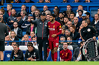 Jurgen Klopp manager of Liverpool talks to Joe Gomez of Liverpool during the Premier League match between Chelsea and Liverpool at Stamford Bridge, London, England on 22 September 2019. Photo by Liam McAvoy / PRiME Media Images.