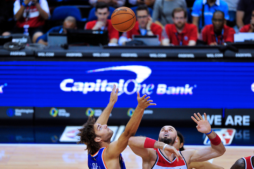 Robin Lopez of the Knicks and Marcin Gortat of the Wizards tip-of the ball at the Verizon Center in Washington, D.C. on Friday, October 9, 2015.  Alan P. Santos/DC Sports Box