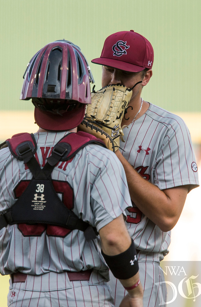 NWA Democrat-Gazette/BEN GOFF @NWABENGOFF<br /> Adam Hill, South Carolina pitcher, confers with catcher Hunter Taylor Saturday, June 9, 2018, during game one of the NCAA Super Regional at Baum Stadium in Fayetteville.