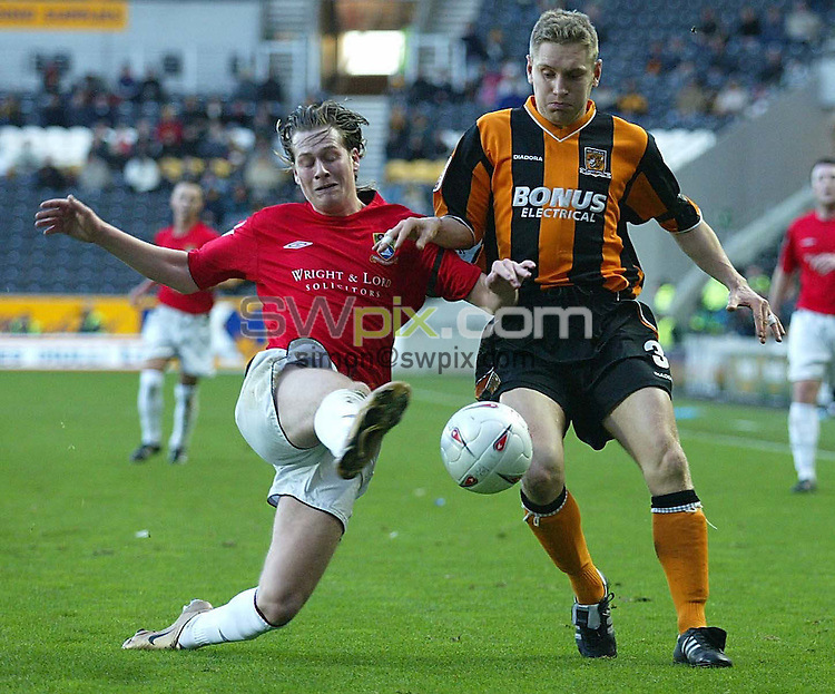 Pix:John Clifton/SWpix.com. Football. 13/11/2004. FA CUP. Hull City v Morecambe..COPYRIGHT PICTURE>>SIMON WILKINSON>>01943 608782>>..PHOTO: JOHN CLIFTON.Jamie Heard - Morecambe clears the ball from Hull's Andy Dawson..