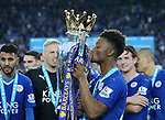 Leicester's Demarai Gray celebrates with the trophy during the Barclays Premier League match at the King Power Stadium.  Photo credit should read: David Klein/Sportimage