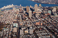 Quebec city's skyline is pictured from West to East in this aerial photo November 11, 2009. In this picture can be seen St-Jean-Baptiste district, Montcalm district Complexe G (edifice Marie-Guyard), Hotel Delta, Hotel Hilton, Hotel Lowes Le Concorde, Chateau Frontenac, Bunge grain Silo and the St-Lawrence river.