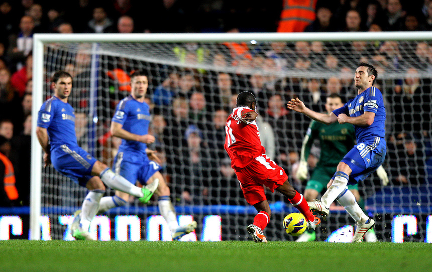 Queens Park Rangers' Shaun Wright-Phillips scores his sides first goal  1-0..Football - Barclays Premiership - Chelsea v Queens Park Rangers - Wednesday 2nd January 2013 - Stamford Bridge - London..¨© CameraSport - 43 Linden Ave. Countesthorpe. Leicester. England. LE8 5PG - Tel: +44 (0) 116 277 4147 - admin@camerasport.com - www.camerasport.com