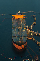 An Oil Tanker loading at Kinder Morgan Westridge Marine Tanker Terminal in Burrard Inlet.