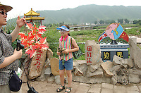 01-AUG-02: NORTH KOREAN BORDER: TUMEN, JILIN, CHINA<br /> Surreal normality on the North Korean border as a   South Korean family of tourists take photographs at the Tumen Bridge border crossing where refugees are sent back to the North.