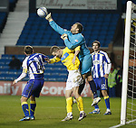 Cammy Bell punches clear for Kilmarnock.