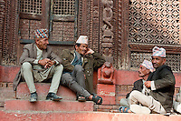 Kathmandu, Nepal.  Nepali men talking on the steps of the Shiva-Parvati Temple, Durbar Square.