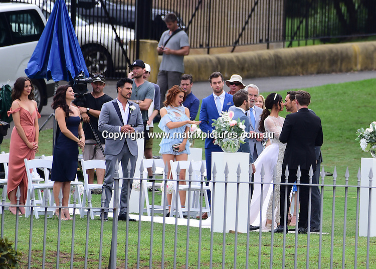 14 February 2017 SYDNEY AUSTRALIA<br /> WWW.MATRIXPICTURES.COM.AU<br /> <br /> EXCLUSIVE PICTURES<br /> The Bold and the Beautiful cast  wedding of <br /> Courtney Hope to Jacqueline McInnes Wood with Thorsten Kaye as the father giving away the bride, on Bennelong Lawn, Sydney harbour, Sydney, Australia on 14 February 2017 .<br /> <br /> *No internet without clearance*.<br /> <br /> MUST CALL PRIOR TO USE <br /> <br /> +61 2 9211-1088. <br /> <br /> Matrix Media Group.Note: All editorial images subject to the following: For editorial use only. Additional clearance required for commercial, wireless, internet or promotional use.Images may not be altered or modified. Matrix Media Group makes no representations or warranties regarding names, trademarks or logos appearing in the images.