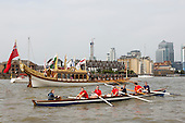 Greenwich, London, UK. 7 September 2014. The Royal row barge Gloriana with Canary Wharf at the back. Her Majesty the Queen's row barge Gloriana leads a  Royal Pageant up the River Thames from Martime Greenwich during the Tall Ships Festival, Greenwich, London, UK. Photo: Bettina Strenske