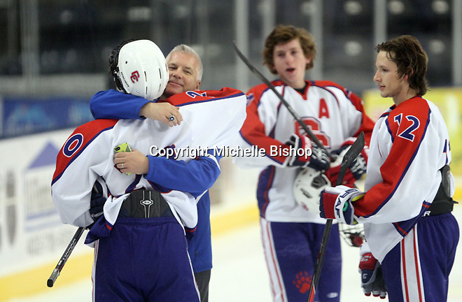 Cherry Creek's Joshua Yovich (20) and head coach Jeff Mielnicki. Cherry Creek (Colorado) beat Medina (Ohio) 5-1 on the third day of pool play during the 2014 High School Hockey National Championship in Omaha on March 28. (Photo by Michelle Bishop)