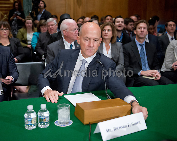 """Richard F. Smith, former Chairman and Chief Executive Officer, Equifax, Inc. arranges his name card prior to giving testimony before the United States Senate Committee on Banking, Housing, and Urban Affairs as they conduct a hearing entitled, """"An Examination of the Equifax Cybersecurity Breach"""" on Capitol Hill in Washington, DC on Tuesday, October 3, 2017. Photo Credit: Ron Sachs/CNP/AdMedia"""