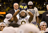 Martavious Odoms of Michigan celebrates after winning Sugar Bowl game against Virginia Tech at Mercedes-Benz SuperDome in New Orleans, Louisiana on January 3rd, 2012.  Michigan defeated Virginia Tech, 23-20 in first overtime.