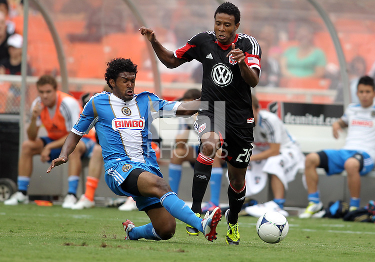 WASHINGTON, D.C. - AUGUST 19, 2012:  Lionard Pajoy (26) of DC United loses the ball to a slide tackle from Sheanon Williams (25) of the Philadelphia Union during an MLS match at RFK Stadium, in Washington DC, on August 19. The game ended in a 1-1 tie.