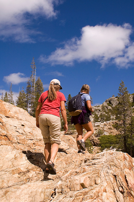 Women hiking a trail along Canyon Creek, Tahoe National Forest California